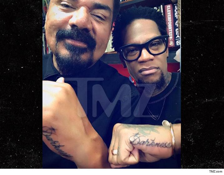 George Lopez and D.L. Hughley seal their affection for Charlie Murphy with a tattoo. (Photo: TMZ)