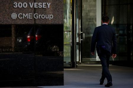 A man enters the CME Group offices in New York