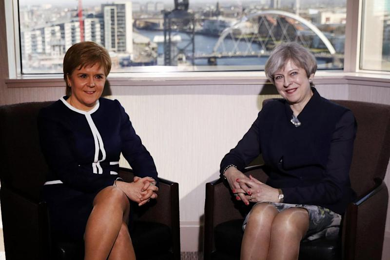 Nicola Sturgeon and Theresa May met for a chat on Monday ahead of Tuesday's vote. (Russell Cheyne/PA)