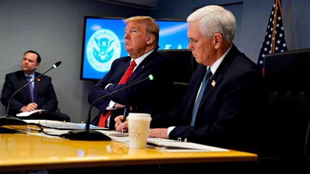PHOTO: President Donald Trump and Vice President Mike Pence attend a teleconference with governors at the Federal Emergency Management Agency (FEMA) headquarters, March 19, 2020, in Washington. (Evan Vucci/POOL/AFP via Getty Images)