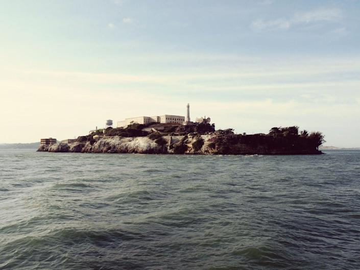 """<p>Alcatraz Island is home to one of the most haunted prisons in America. Located in the <a href=""""https://www.housebeautiful.com/design-inspiration/house-tours/g3553/john-mayberry-antonio-martins-san-francisco-apartment/"""" rel=""""nofollow noopener"""" target=""""_blank"""" data-ylk=""""slk:San Francisco"""" class=""""link rapid-noclick-resp"""">San Francisco</a> Bay, Alcatraz was built in 1859 but didn't become a federal penitentiary until 1934. Up until 1963, Alcatraz housed many of the world's most notorious criminals and was also the site of prison personnel murders, inmate suicides, and escape deaths—which <em>kind </em><span class=""""redactor-invisible-space"""">of explains why so many people get the heebie-jeebies when inside. The former prison has <em>all </em><span class=""""redactor-invisible-space"""">the <a href=""""https://www.housebeautiful.com/lifestyle/a6622/is-my-house-haunted/"""" rel=""""nofollow noopener"""" target=""""_blank"""" data-ylk=""""slk:standard signs of paranormal activity"""" class=""""link rapid-noclick-resp"""">standard signs of paranormal activity</a>. </span>Classic ghosts in chains are reported to make a raucous at night, in addition to standard wailing and moaning; many reports maintain that these noises come from the ghosts of Native American and Civil War prisoners who died on the island and during the war. But perhaps the most chilling account is of <a href=""""https://en.wikipedia.org/wiki/Legends_of_Alcatraz#Reported_activity_in_the_prison"""" rel=""""nofollow noopener"""" target=""""_blank"""" data-ylk=""""slk:one inmate in D-block"""" class=""""link rapid-noclick-resp"""">one inmate in D-block</a>, who reported seeing red eyes in his cell. He screamed all night long—and in the morning, he was found dead and completely alone, strangled to death. D-block is considered to be the most haunted section of the prison, with one cell that is permanently 20 to 30 degrees colder than any other spot in the building. It makes sense that Senator Robert Kennedy decommissioned Alcatraz in the early 1960s—and honestly? We're really """