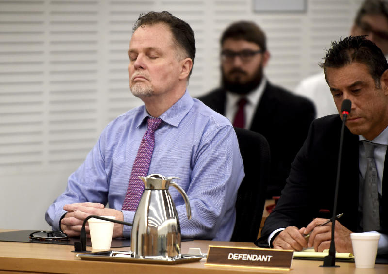 Photo of Merritt reacting to being found guilty of four counts of first-degree murder of the McStay family.