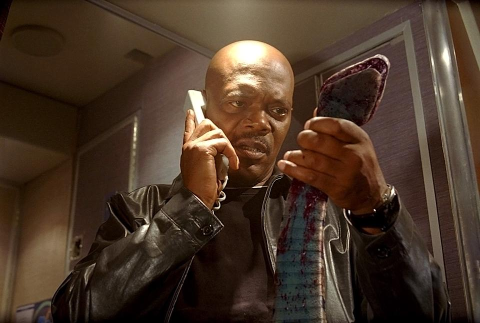 Samuel L. Jackson examines one of the villains of the 2006 thriller, 'Snakes on a Plane' (Photo: New Line Cinema / Courtesy: Everett Collection)