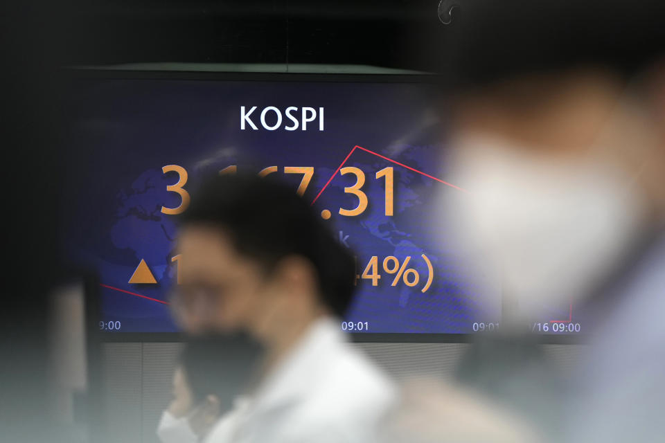 Currency traders watch computer monitors near a screen showing the Korea Composite Stock Price Index (KOSPI) at a foreign exchange dealing room in Seoul, South Korea, Thursday, Sept. 16, 2021. Stocks were mostly lower in Asia on Thursday after Japan and China released data that were weaker than expected. (AP Photo/Lee Jin-man)