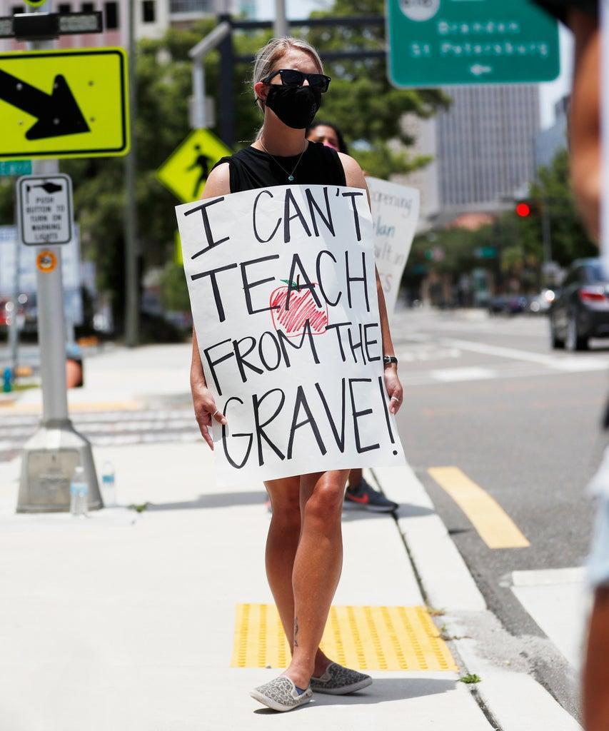 TAMPA, FL – JULY 16: Middle school teacher Brittany Myers, stands in protest in front of the Hillsborough County Schools District Office on July 16, 2020 in Tampa, Florida. Teachers and administrators from Hillsborough County Schools rallied against the reopening of schools due to health and safety concerns amid the COVID-19 pandemic. (Photo by Octavio Jones/Getty Images)
