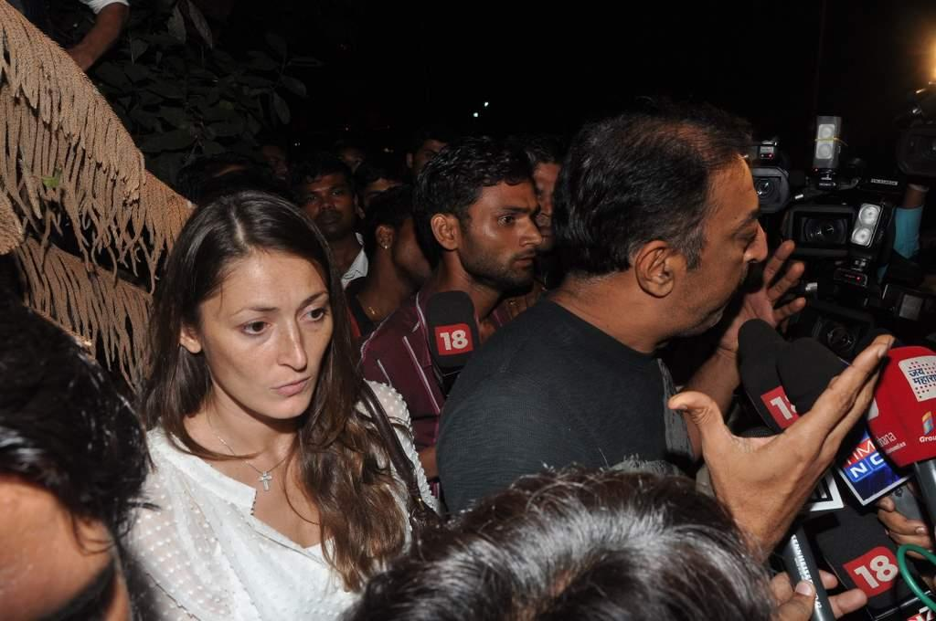 "Vindoo Dara Singh talks to reporters as his wife Dina Umarova looks on. About his friendship with Sakshi, India captain MS Dhoni's wife, Vindoo said, ""I never spoke to Dhoni or his wife. Biggest mistake of my life was to sit with Sakshi Dhoni. Feel very sorry for her."" (Sanskrity Media)"