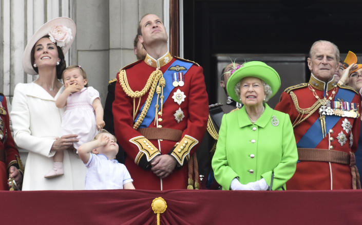 Members of the royal family, including Catherine, Duchess of Cambridge holding Princess Charlotte, Prince George, Prince William, Queen Elizabeth, and Prince Philip stand on the balcony of Buckingham Palace after the annual Trooping the Colour ceremony on Horseguards Parade in central London, Britain June 11, 2016. Trooping the Colour is a ceremony to honour Queen Elizabeth's official birthday. The Queen celebrates her 90th birthday this year.   REUTERS/Toby Melville