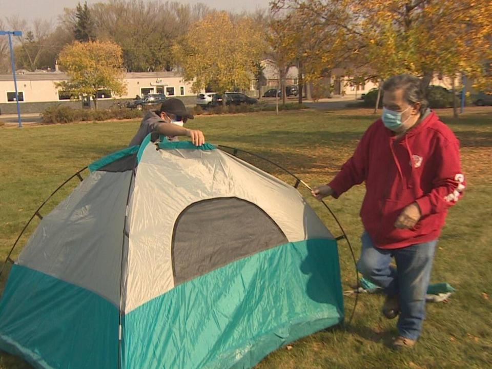 The first of what advocates hope to be many tents was set up in Pepsi Park in Regina Friday afternoon in preparation for a temporary winter shelter for people experiencing homelessness.  (Richard Agecoutay/CBC News - image credit)