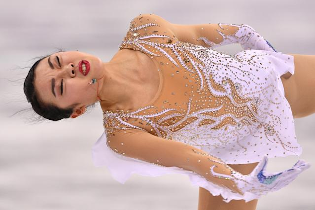 <p>USA's Karen Chen competes in the women's single skating short program of the figure skating event during the Pyeongchang 2018 Winter Olympic Games at the Gangneung Ice Arena in Gangneung on February 21, 2018. / AFP PHOTO / Mladen ANTONOV </p>