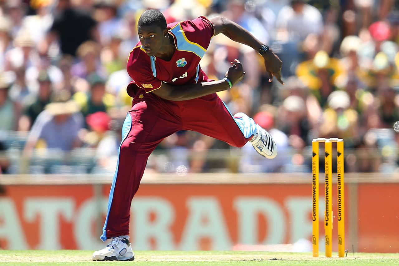 PERTH, AUSTRALIA - FEBRUARY 01:  Jason Holder of the West Indies bowls during game one of the Commonwealth Bank One Day International Series between Australia and the West Indies at WACA on February 1, 2013 in Perth, Australia.  (Photo by Paul Kane/Getty Images)
