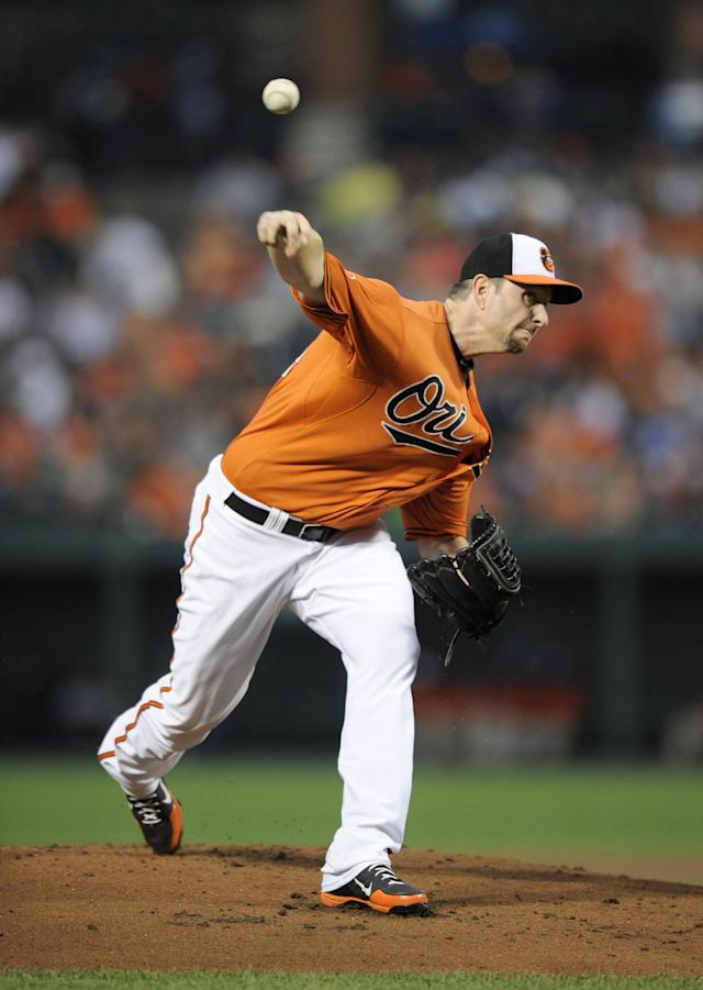 Baltimore Orioles starting pitcher Scott Feldman delivers a pitch against the Seattle Mariners during the fist inning of a baseball game, Saturday, Aug. 3, 2013, in Baltimore. (AP Photo/Nick Wass)