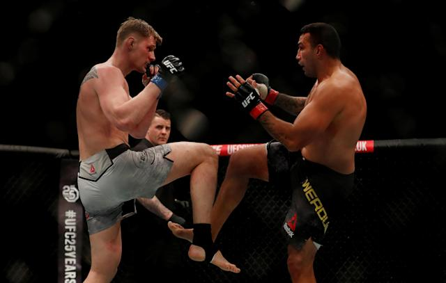Ultimate Fighting Championship - UFC Fight Night - Fabricio Werdum vs Alexander Volkov - O2 Arena, London, Britain - March 17, 2018 Alexander Volkov of Russia (L) and Fabricio Werdum of Brazil (R) in action REUTERS/Matthew Childs