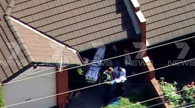 A Glenroy woman has been wheeled out by paramedics with critical stab wounds. Picture: 7 News