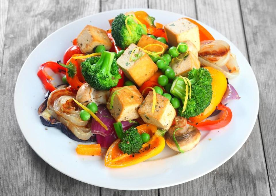 Going vegetarian could be your ticket to weight loss, according to a new study. Pictured here is a salad with tofu.