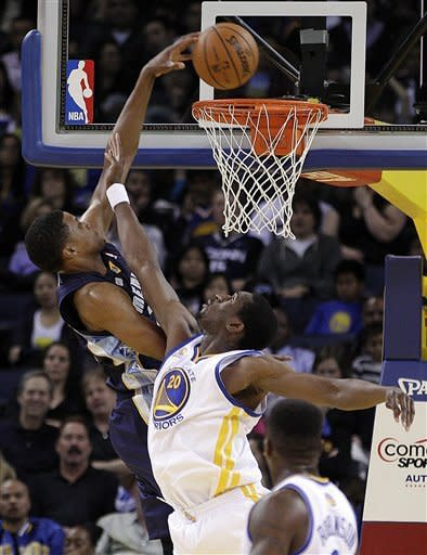 Memphis Grizzlies' Rudy Gay scores over Golden State Warriors' Ekpe Udoh during the first half of an NBA basketball game Wednesday, March 7, 2012, in Oakland, Calif. (AP Photo/Ben Margot)