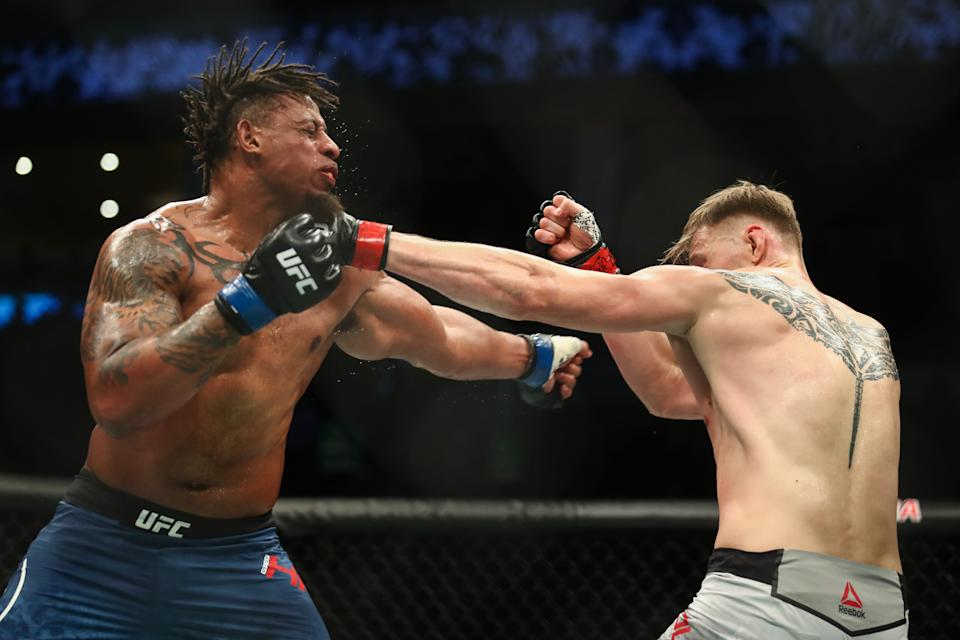 MOSCOW, RUSSIA  NOVEMBER 10, 2019: UFC heavyweight fighters Greg Hardy (L) of the United States and Alexander Volkov of Russia in a bout as part of the UFC Fight Night 163 mixed martial arts event, at CSKA Arena. Valery Sharifulin/TASS (Photo by Valery Sharifulin\TASS via Getty Images)