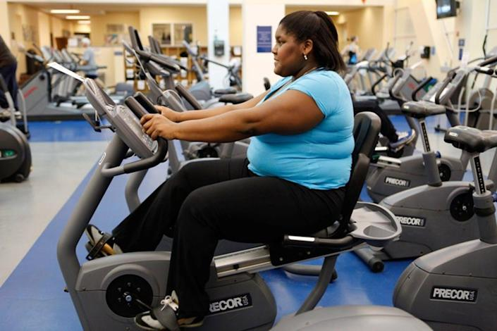 """<span class=""""caption"""">A woman exercising on a stationary bike. Exercise is an important component of weight loss, most experts agree.</span> <span class=""""attribution""""><a class=""""link rapid-noclick-resp"""" href=""""http://creativecommons.org/licenses/by-sa/4.0/"""" rel=""""nofollow noopener"""" target=""""_blank"""" data-ylk=""""slk:CC BY-SA"""">CC BY-SA</a></span>"""
