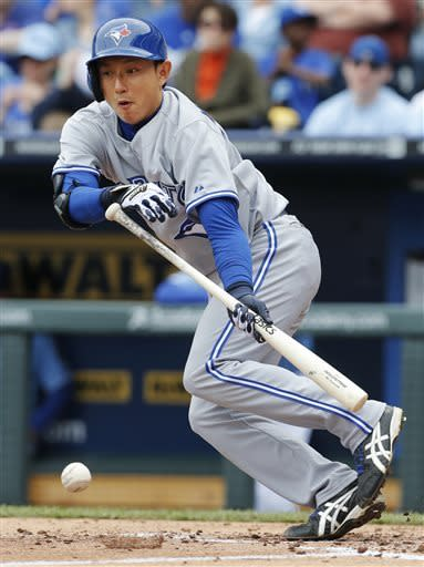 Toronto Blue Jays' Munenori Kawasaki hits a bunt-single during the third inning of a baseball game against the Kansas City Royals at Kauffman Stadium in Kansas City, Mo., Sunday, April 14, 2013. (AP Photo/Orlin Wagner)