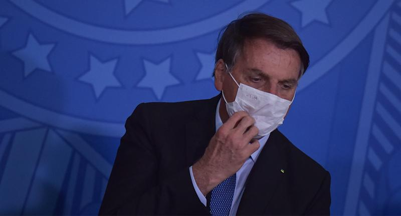 Photo of Brazilian President Jair Bolsonaro wearing a face mask after announcing he has COVID-19.