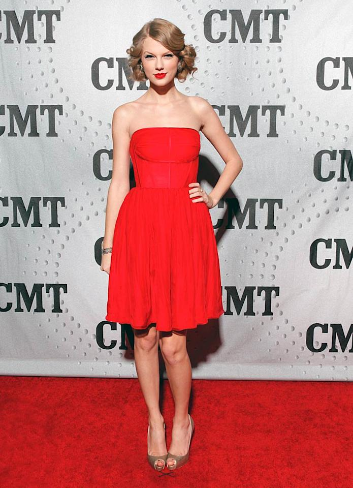 Country cutie Taylor Swift also opted to wear a festive scarlet strapless dress -- along with her signature red lips -- while being honored at the CMT Artist of the Year celebration in Nashville, Tennessee. (11/29/2011)