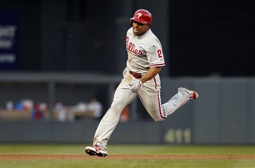 Philadelphia Phillies' Ben Revere (2) runs to third base on his triple against Minnesota Twins starting pitcher Kevin Correia during the fourth inning of a baseball game on Thursday, June 13, 2013, in Minneapolis. (AP Photo/Genevieve Ross)