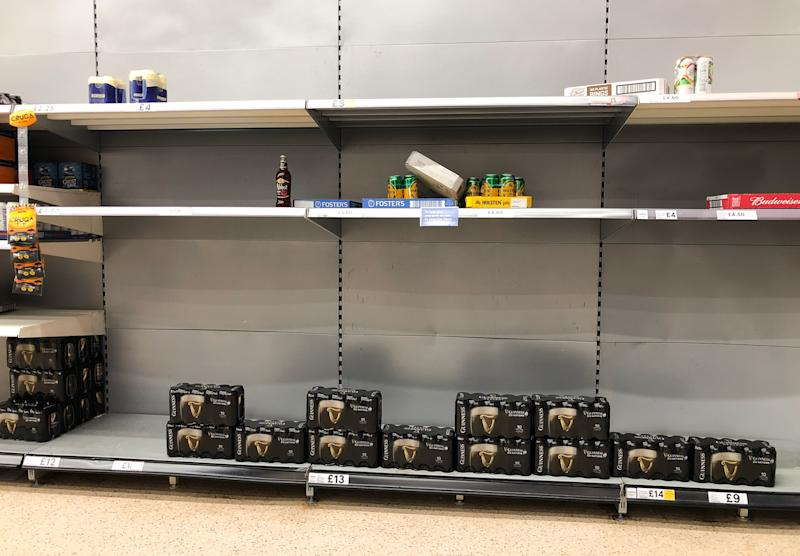 Shelves of beer and lager at a Tesco supermarket in Leicester, after Prime Minister Boris Johnson ordered pubs, restaurants, leisure centres and gyms across the country to close as the Government announced unprecedented measures to cover the wages of workers who would otherwise lose their jobs due to the coronavirus outbreak. (Photo by Joe Giddens/PA Images via Getty Images)