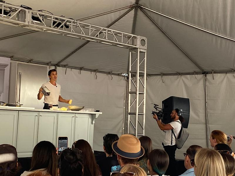 """Antoni Porowski from """"Queer Eye"""" cooks latkes and answers fans' questions during his cooking demonstration at the festival."""