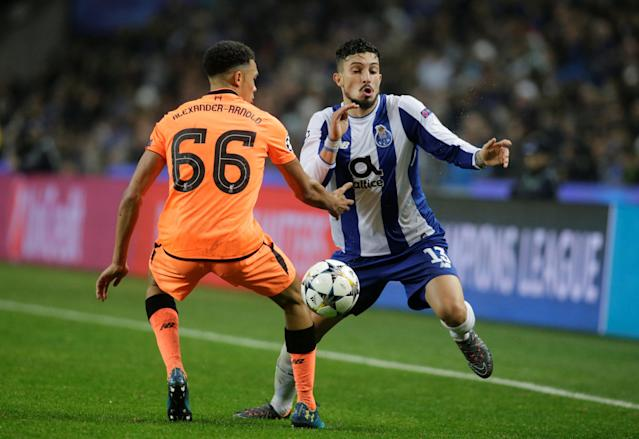 Soccer Football - Champions League Round of 16 First Leg - FC Porto vs Liverpool - Estadio do Dragao, Porto, Portugal - February 14, 2018 Porto's Alex Telles in action with Liverpool's Trent Alexander-Arnold REUTERS/Miguel Vidal