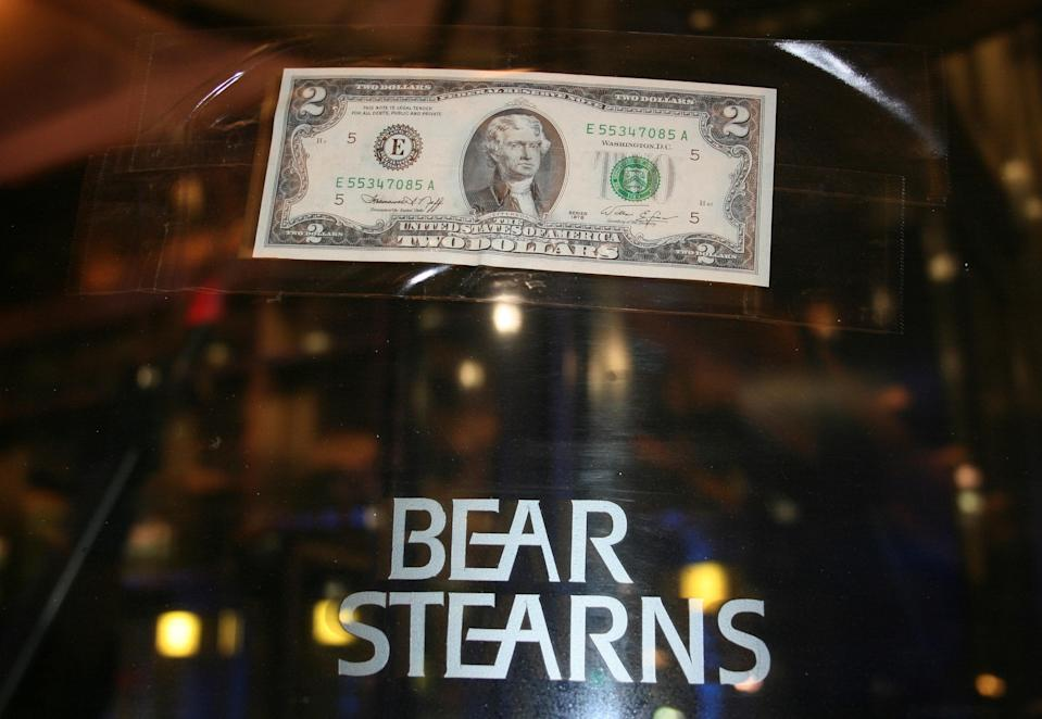 A U.S. two dollar bill is taped to the revolving door leading to the Bear Stearns global headquarters in New York, U.S., March 17, 2008. REUTERS/Kristina Cooke