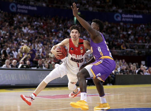 LaMelo Ball of the Illawarra Hawks drives past Jae'Sean Tate of the Sydney Kings during a game in the Australian National Basketball League in Sydney on Nov. 17, 2019. (AP Photo/Rick Rycroft)