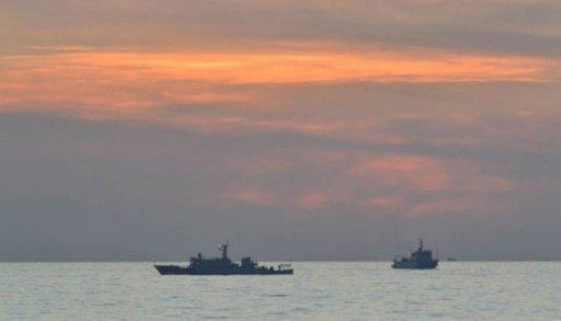 A Philippine navy photo shows Chinese surveillance ships off Scarborough Shoal, on April 11. The Philippines said it remained locked in a stalemate with China over a disputed shoal in the South China Sea