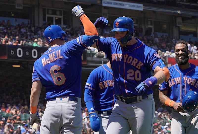 SAN FRANCISCO, CA - JULY 20: Pete Alonso #20 of the New York Mets is congratulated by Jeff McNeil #6 after Alonso hit a pinch-hit three-run home run against the San Francisco Giants in the top of the six inning at Oracle Park on July 20, 2019 in San Francisco, California. (Photo by Thearon W. Henderson/Getty Images)