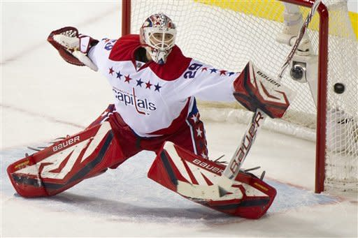 Washington Capitals goalie Tomas Vokoun deflects a shot as they face the Montreal Canadiens during second period NHL hockey action, Saturday, Feb. 4, 2012 in Montreal. (AP Photo/The Canadian Press, Paul Chiasson)