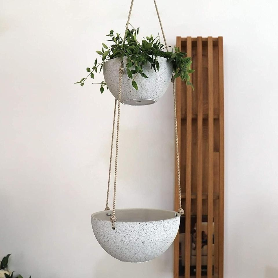 <p>The <span>La Jolie Muse 2 Tier Modern Hanging Planters</span> ($28) will work wonders for plants that droop and spill over like a waterfall.</p>