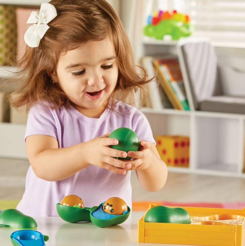 """A love for guacamole's main ingredient should start at an early age. Plus, this toy really helps with the color identification and matching skills.Did you know avocados are also called alligator pears and that botanically, they are classified as a berry? Well, now you do.<br /><br /><strong>Get it from Target for <a href=""""https://go.skimresources.com?id=38395X987171&xs=1&url=https%3A%2F%2Fwww.target.com%2Fp%2Flearning-resources-learn-a-lot-avocados-4pc%2F-%2FA-79406186&xcust=HPToddlerBirthday60919842e4b02e74d22c817c"""" target=""""_blank"""" rel=""""noopener noreferrer"""">$12.39</a>.</strong>"""