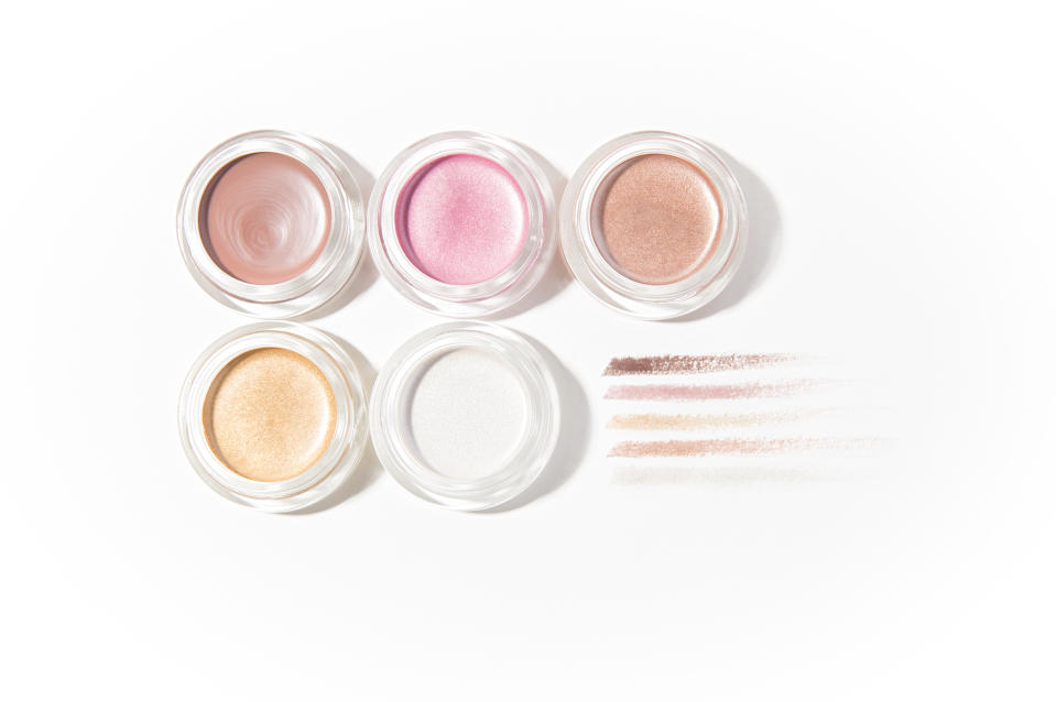Cream eyeshadows pots and swatches on white background