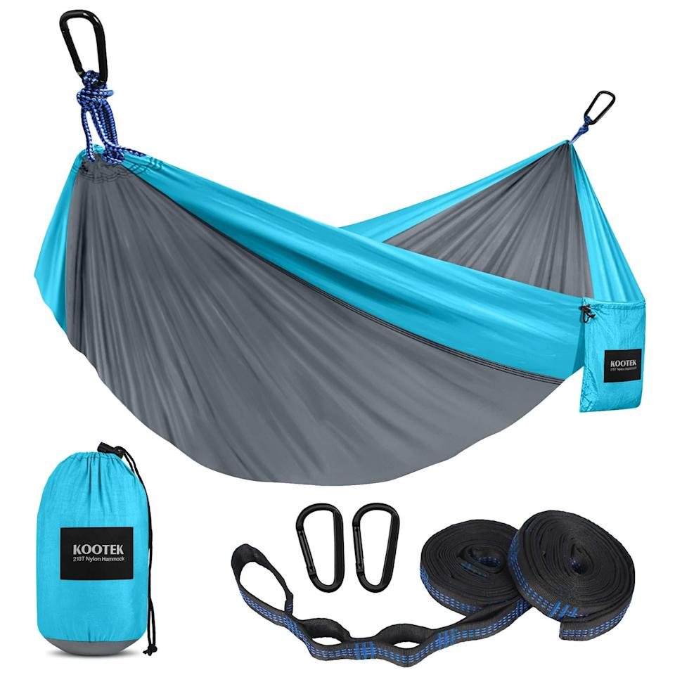 """<h2>Best Affordable Hammock<br></h2><br><h3>Kootek Camping Hammock With 2 Tree Straps</h3><br><strong>The Hype:</strong> 4.8 out of 5 stars and 19,640 ratings<br><br><strong>Reviewers say</strong>: """"This is our first hammock, and we love it! The fabric is lightweight yet sturdy and it dries off pretty quickly after getting some rain on it. Size is plenty for a single adult to stretch out and have fabric left over to cover yourself...[it's] all-around great product for a great price.""""<br><br><em>Shop</em> <strong><em><a href=""""https://amzn.to/3i7B87G"""" rel=""""nofollow noopener"""" target=""""_blank"""" data-ylk=""""slk:Kootek"""" class=""""link rapid-noclick-resp"""">Kootek</a></em></strong><br><br><strong>Kootek</strong> Camping Hammock with 2 Tree Straps, $, available at <a href=""""https://amzn.to/3edPdiM"""" rel=""""nofollow noopener"""" target=""""_blank"""" data-ylk=""""slk:Amazon"""" class=""""link rapid-noclick-resp"""">Amazon</a>"""