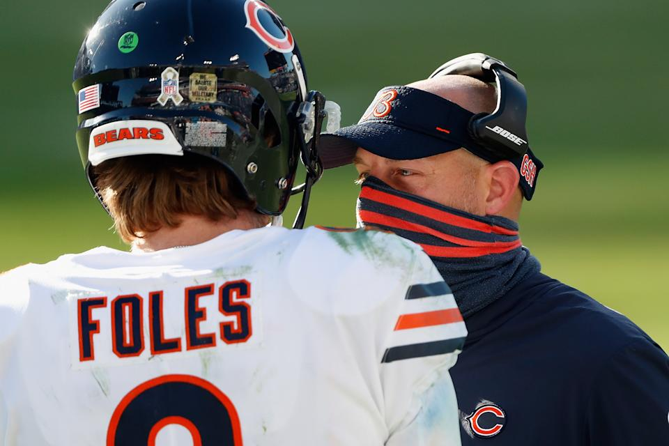 Head coach Matt Nagy of the Chicago Bears talks with quarterback Nick Foles