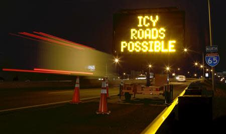 A travel warning sign is seen along Interstate 65 as cold weather descends on Mobile, Alabama January 28, 2014. REUTERS/Lyle Ratliff (UNITED STATES - Tags: ENVIRONMENT)