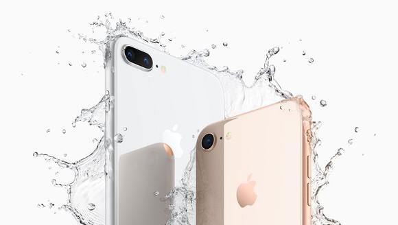 Apple's iPhone 8 Plus on the left and the iPhone 8 on the right splashing into water.