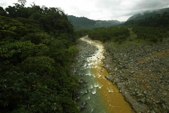 "The Rio Sucio or ""Dirty River,"" where one branch is colored yellow/brown by the minerals it carries from the Irazu Volcano, is seen mixing with the clear waters filtered by the tropical rainforest in the Braullio Carrillo National Park, 50 km (31 miles) east of San Jose, June 5, 2012."