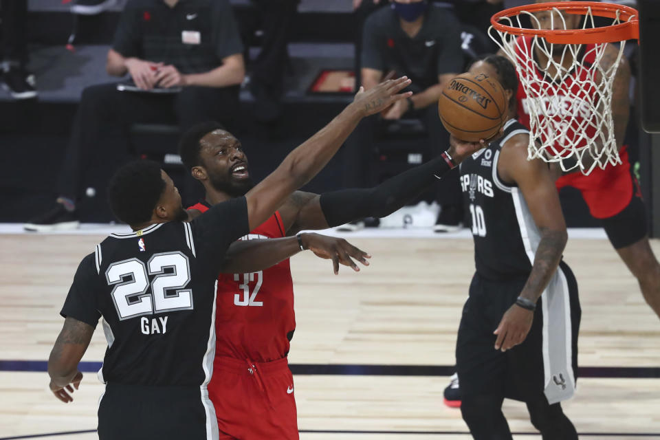 Houston Rockets forward Jeff Green (32) goes up for a shot while San Antonio Spurs forward Rudy Gay (22) defends during the first half of a NBA basketball game Tuesday, Aug. 11, 2020, in Lake Buena Vista, Fla. (Kim Klement/Pool Photo via AP)