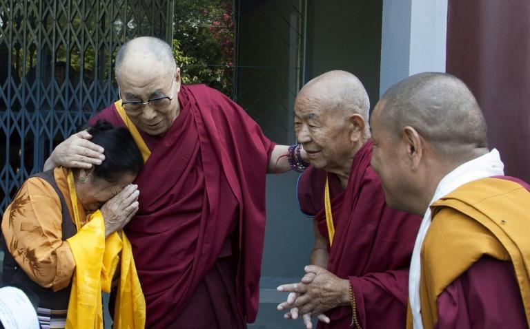 The Dalai Lama greets Tibetans in exile in his base in the Indian hill town of Dharamshala in 2016 (AFP Photo/STR)