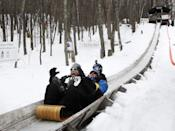 "Though the slopes may be far <a href=""https://www.cntraveler.com/story/the-best-vermont-ski-resorts?mbid=synd_yahoo_rss"" rel=""nofollow noopener"" target=""_blank"" data-ylk=""slk:more impressive in Vermont"" class=""link rapid-noclick-resp"">more impressive in Vermont</a>, at <a href=""https://www.camdensnowbowl.com"" rel=""nofollow noopener"" target=""_blank"" data-ylk=""slk:Camden Snow Bowl"" class=""link rapid-noclick-resp"">Camden Snow Bowl</a> in Maine, you can peer over the Atlantic from the summit before charging down the slopes. Even better is the mountain's ultimate adrenaline rush: a 440-foot-long wooden toboggan chute, which is open to the public on weekends outside the U.S. National Toboggan Championships, which runs from February 5 to 7 in 2021. Of all the great things to do in new England in the winter, this just might be your kids' favorite."
