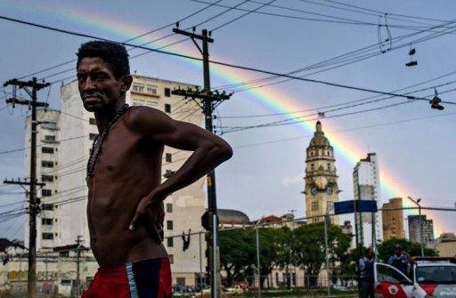 """A homeless man walks in the street, in an area called """"Cracolandia"""" (Crackland in English), in downtown Sao Paulo, Brazil on January 14. A muscular police operation to evict drug users from central Sao Paulo is triggering howls of protest from rights groups who say the crackdown's aim is to sanitize the area for developers"""