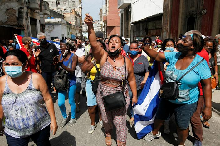 Cuban government supporters take to the streets of Havana in early July.