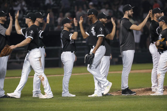 The Chicago White Sox celebrate the team's 7-3 win over the Kansas City Royals in a baseball game Tuesday, Sept. 10, 2019, in Chicago. (AP Photo/Charles Rex Arbogast)