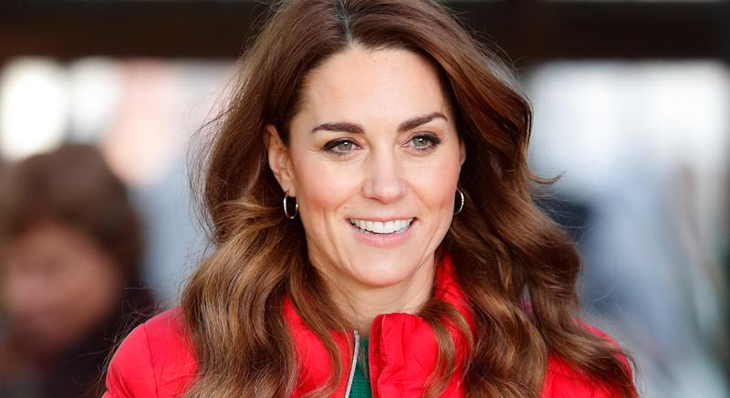 Kate Middleton wearing a bright red jacket.