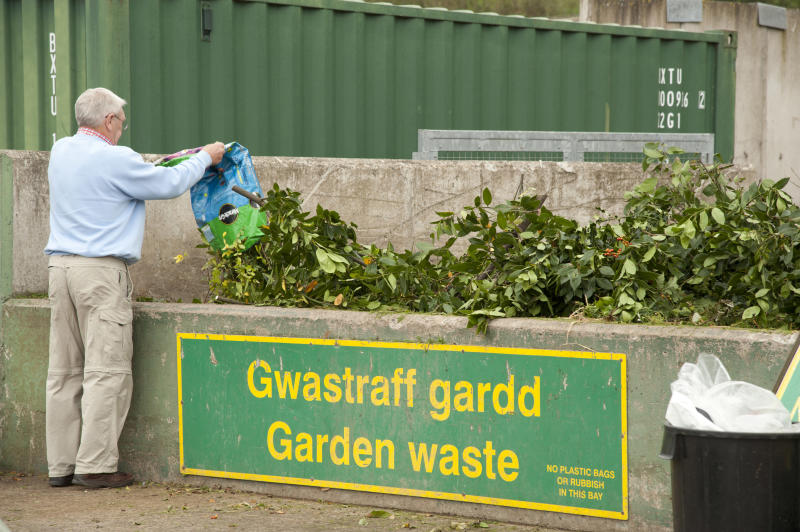 A man dumping sacks of green garden waste at a recycling centre UK. (Photo by: Photofusion/Keith Morris/Universal Images Group via Getty Images)
