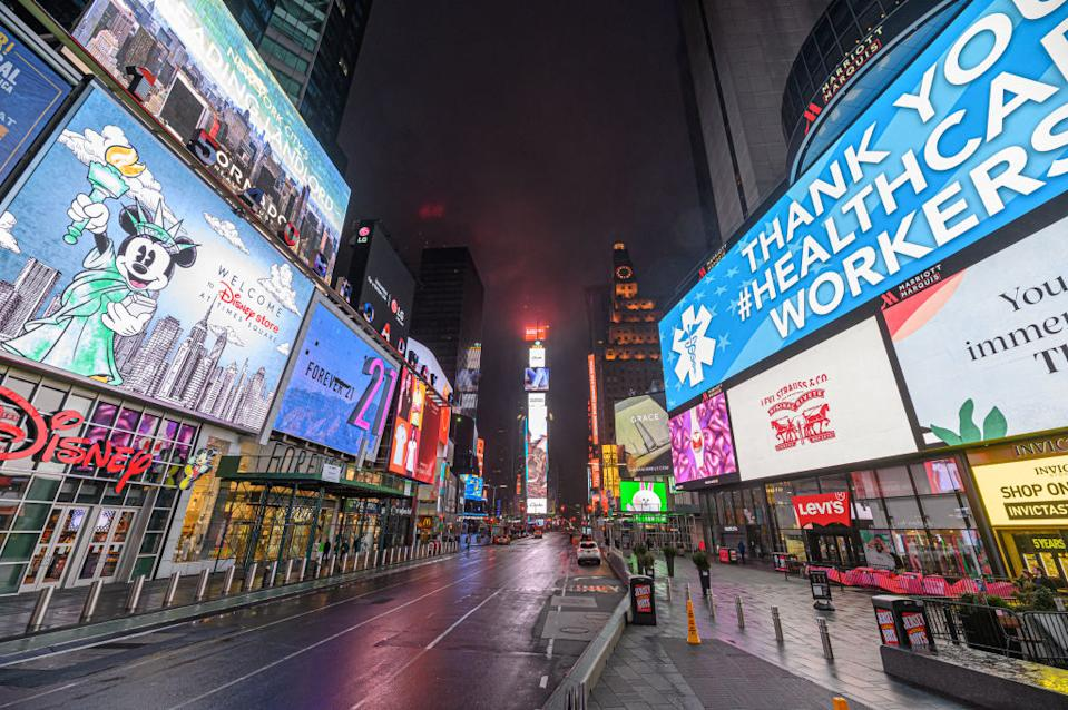 Lights shine still in Times Square as people remain at home amid lockdown measures in New York. Source: Getty